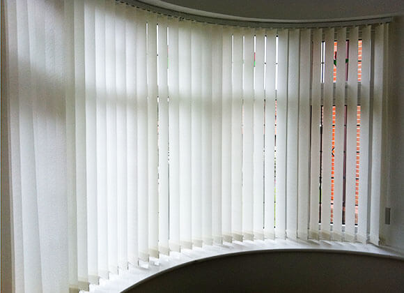 Vertical blind curved bay window a z blinds runcorn for Curved bay window